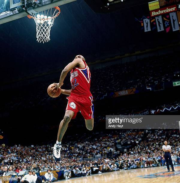 Jerry Stackhouse of the Philadelphia 76ers attempts a dunk during the 1996 Slam Dunk Contest on February 10 1996 at the Alamodome in San Antonio...