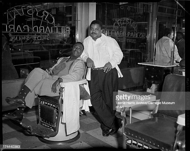 Jerry Sumpter and barber Clarence Williams posed inside William 'Woogie' Harris's Crystal Barber Shop on Wylie Avenue Hill District Pittsburgh...