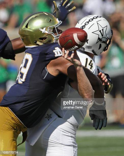 Jerry Tillery of the Notre Dame Fighting Irish hits Kyle Shurmur of the Vanderbilt Commodores as he passes forcing a fumble at Notre Dame Stadium on...