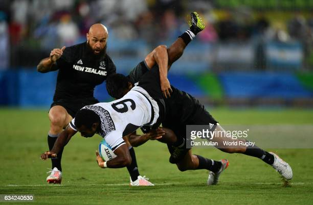 Jerry Tuwai of Fiji is tackled by Reiko Ioane of New Zeland during the Men's Rugby Sevens quarter final match between Fiji and New Zealand on Day...