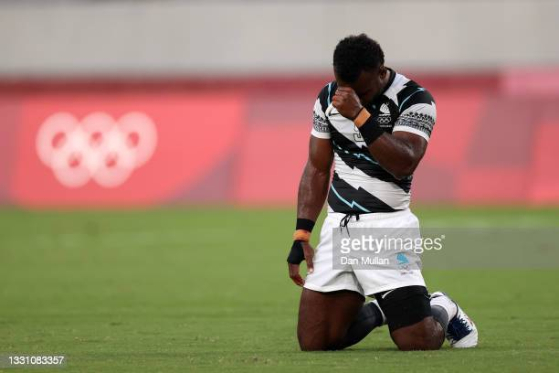 Jerry Tuwai of Team Fiji reacts on the final whistle following victory in the Rugby Sevens Men's Gold Medal match between New Zealand and Fiji on day...