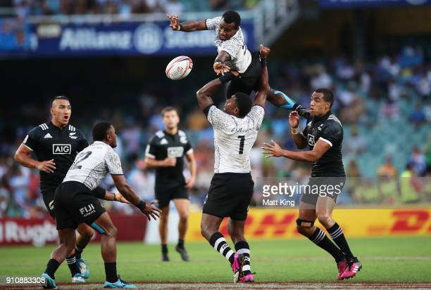Jerry Tuwai Vunisa of Fiji jumps high for the ball in the game against New Zealand during day two of the 2018 Sydney Sevens at Allianz Stadium on...