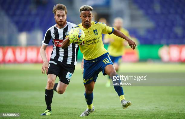 Jerry Voutilainen of VSP Vaasa and Hany Mukhtar of Brondby IF compete for the ball during the UEFA Europa League Qualification match between Brondby...