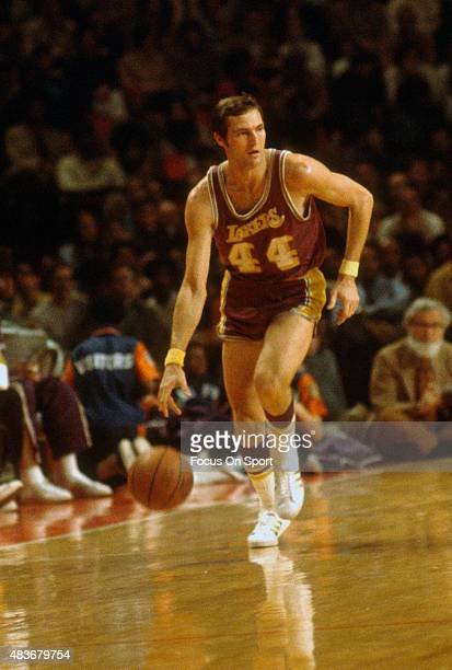 Jerry West of the Los Angeles Lakers dribbles the ball up court against the Baltimore Bullets during an NBA basketball game circa 1972 at the...