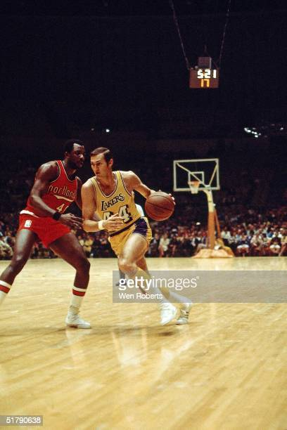 Jerry West of the Los Angeles Lakers drives against the Portland Trailblazers during the NBA game in Los Angeles California NOTE TO USER User...