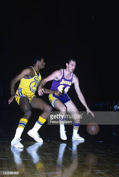 Jerry West of the Los Angeles Lakers drives on Bob Warlick of the San Francisco Warriors during an NBA basketball game circa 1968 at the Cow Palace...
