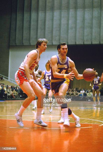 Jerry West of the Los Angeles Lakers drives on Jack Marin of the Baltimore Bullets during an NBA basketball game circa 1970 at the Baltimore Civic...