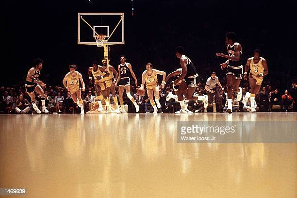 Jerry West of the Los Angeles Lakers drives the ball upcourt against the Milwaukee Bucks during an NBA game in Los Angeles, California. NOTE TO USER:...