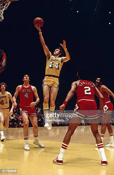 Jerry West of the Los Angeles Lakers drives to the basket agaisnt Jerry Sloan and Norm Van Lier of the Chicago Bulls during the NBA game circa 1971...