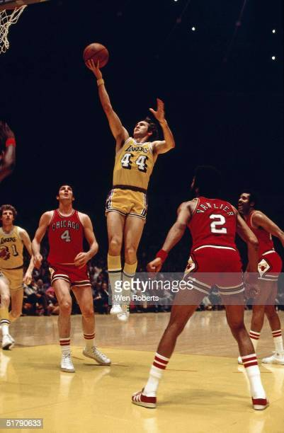 Jerry West of the Los Angeles Lakers goes for a layup agaisnt the Chicago Bulls during the NBA game in Los Angeles California NOTE TO USER User...