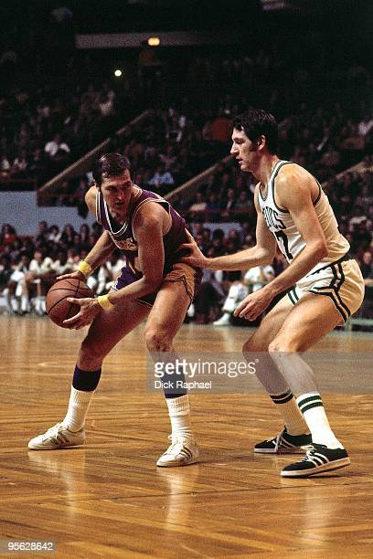 Jerry West of the Los Angeles Lakers looks to make a move against John Havlicek of the Boston Celtics during a game played in 1968 at the Boston...