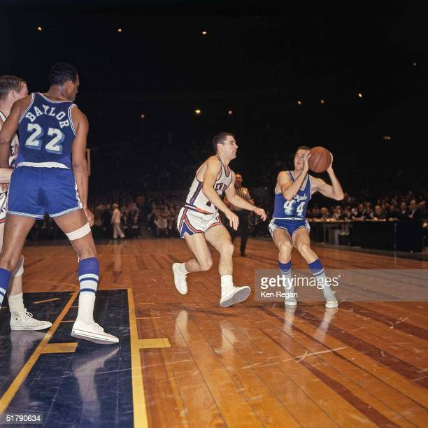 Jerry West of the Los Angeles Lakers looks to make a play against the New York Knicks during the NBA game at Madison Square Garden in New York New...