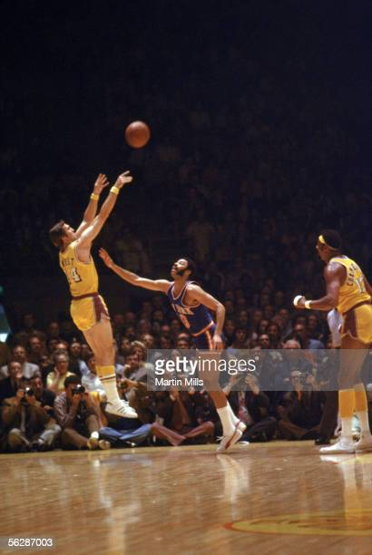 Jerry West of the Los Angeles Lakers shoots a jump shot over Walt Frazier of New York Knicks during a 1971 NBA game at the Great Western Forum in...