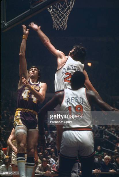 Jerry West of the Los Angeles Lakers shoots over Dave DeBusschere of the New York Knicks during an NBA basketball game circa 1969 at Madison Square...