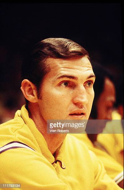 Jerry West of the Los Angeles Lakers sits on the bench during a game at the Great Western Forum in Inglewood California circa 1965 NOTE TO USER User...