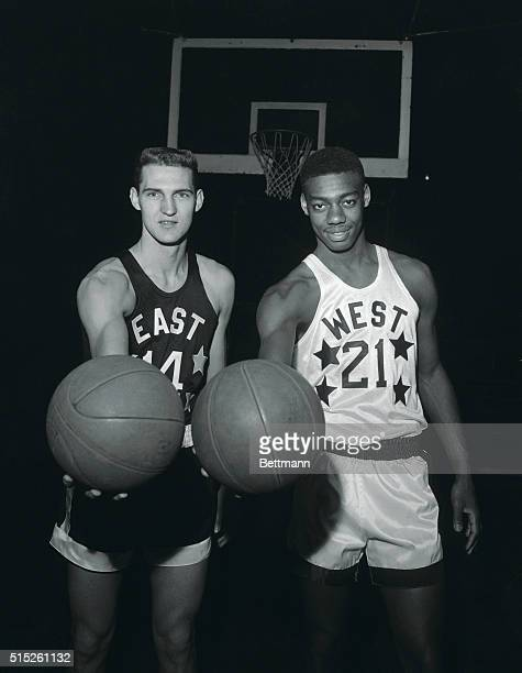 Jerry West, of Virginia , of the Eastern All-Stars, and Oscar Robertson, of Cincinnati, of the Western All-Stars, meet here, March 24, in preparation...