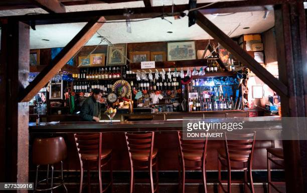 Jerry works behind the bar at Paris Blues jazz club in Harlem on November 17 2017 in New York In 1969 Samuel Hargress bought his Harlem jazz bar and...