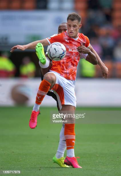 Jerry Yates of Blackpool and Denis Odoi of Fulham in action during the Sky Bet Championship match between Blackpool and Fulham at Bloomfield Road on...