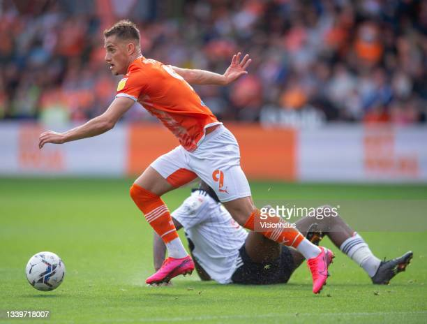 Jerry Yates of Blackpool and Josh Onomah of Fulham in action during the Sky Bet Championship match between Blackpool and Fulham at Bloomfield Road on...