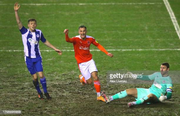 Jerry Yates of Blackpool celebrates after scoring their second goal during the Sky Bet League One match between Wigan Athletic and Blackpool at DW...