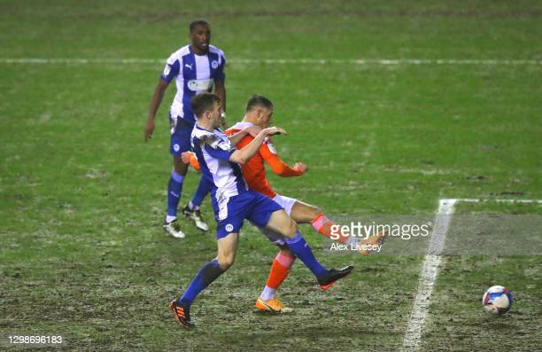 Jerry Yates of Blackpool scores their second goal during the Sky Bet League One match between Wigan Athletic and Blackpool at DW Stadium on January...