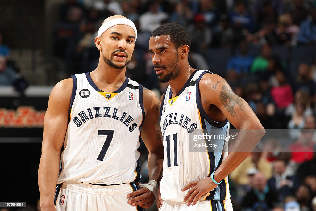 Jerryd Bayless #7 and Mike Conley #11 of the Memphis Grizzlies share a word during the game against the Houston Rockets on March 29, 2013 at FedExForum in Memphis, Tennessee.