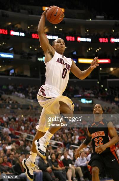 Jerryd Bayless of the Arizona Wildcats dunks over the defense of Calvin Haynes of the Oregon State Beavers during the 2008 Pacific Life Pac10 Men's...