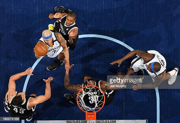 Jerryd Bayless of the Memphis Grizzlies goes to the basket against CJ Watson Kris Humphries and Reggie Evans of the Brooklyn Nets on January 25 2013...