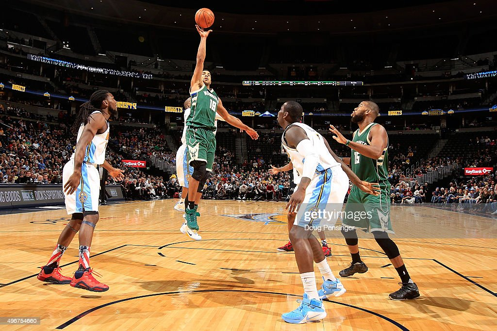 Jerryd Bayless #19 of the Milwaukee Bucks lays up a shot against Kenneth Faried #35 and J.J. Hickson #7 of the Denver Nuggetsat Pepsi Center on November 11, 2015 in Denver, Colorado. The Nuggets defeated the Bucks 103-102.