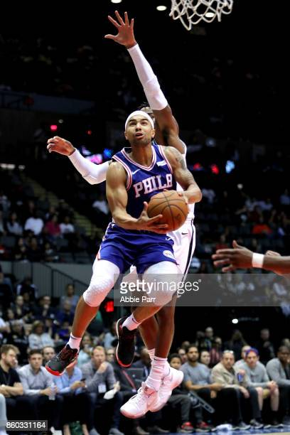 Jerryd Bayless of the Philadelphia 76ers drives to the basket against the Brooklyn Nets during their Pre Season game at Nassau Veterans Coliseum on...