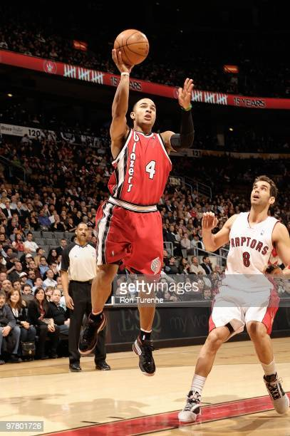 Jerryd Bayless of the Portland Trail Blazers puts up a shot over Jose Calderon of the Toronto Raptors during the game on February 24 2010 at Air...