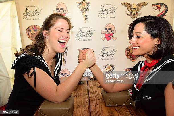 Jerry's the Sailor's Spiced Rum reps Lori LaManna Gabrielle D'Andrea demonstrate the armwresting table The 28th annual NYC Fleet Week brought US navy...