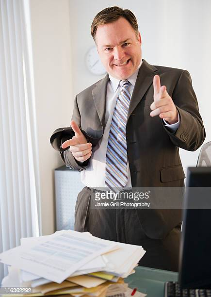 usa, jersey city, new jersey, businessman pointing to camera - bossy stock pictures, royalty-free photos & images