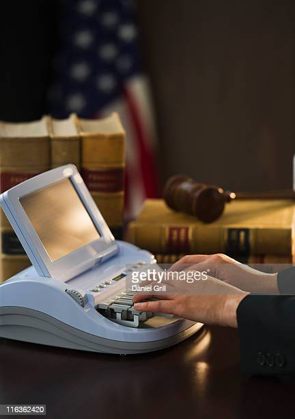 USA, Jersey City, New Jersey, court stenographer using stenograph machine