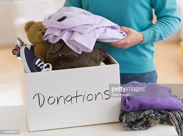 Jersey City, New Jersey, Man packing clothes for donation