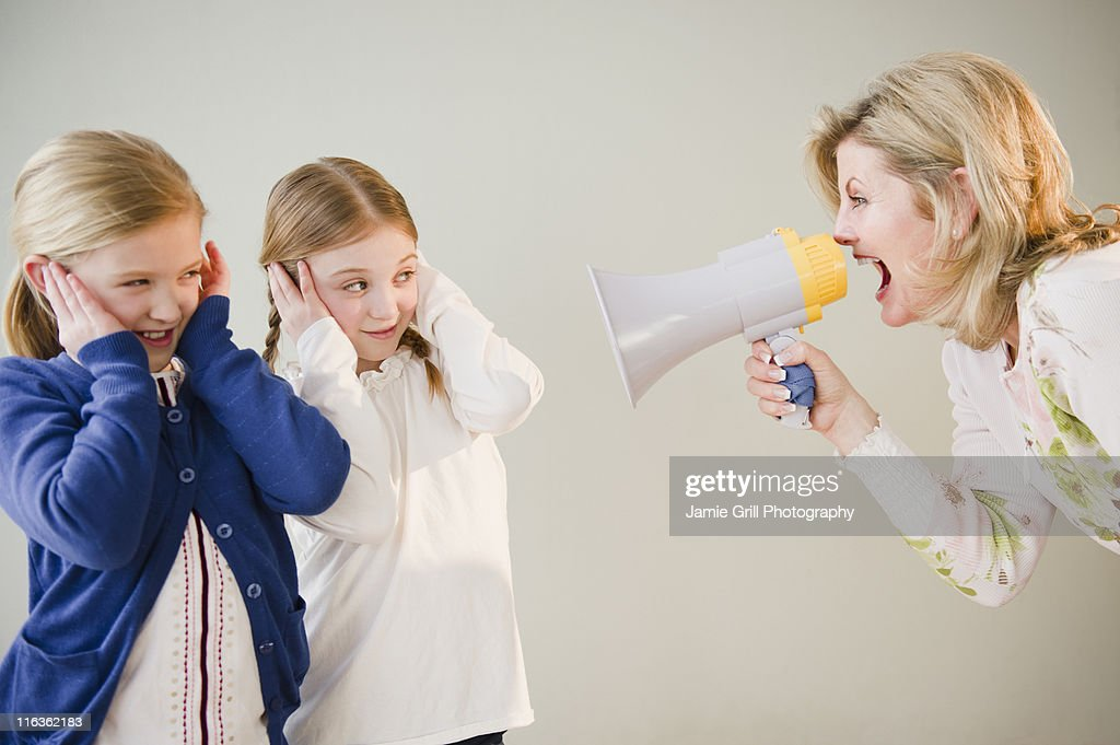 USA, Jersey City, New Jersey, mother shouting at daughters (8-11) through bullhorn : Stock Photo