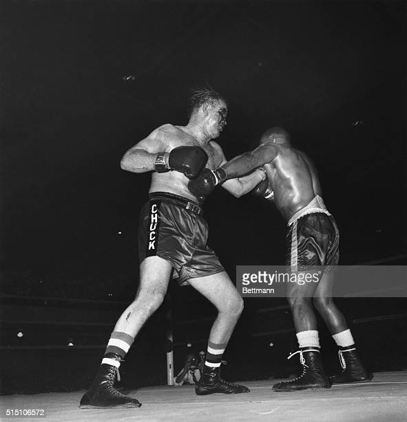 Hardly able to use his right eye New Jersey heavyweight Chuck Wepner still manages to land a left on Sonny Liston during Wepner's battle with the...
