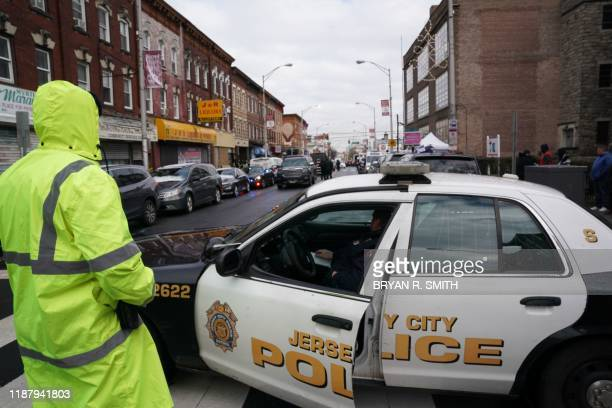 Jersey City Police gather at the scene of the December 10, 2019 shooting at a Jewish Deli on December 11, 2019 in Jersey City, New Jersey. - The...