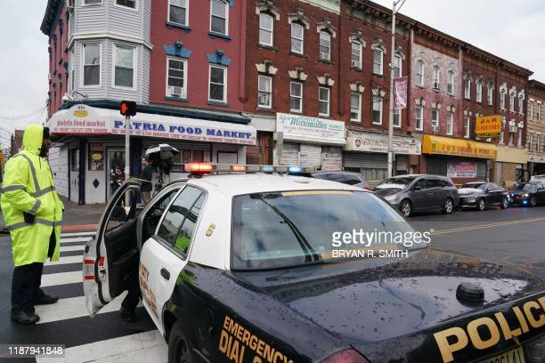 Jersey City Police gather at the scene of the December 10 2019 shooting at a Jewish Deli on December 11 2019 in Jersey City New Jersey The shooters...