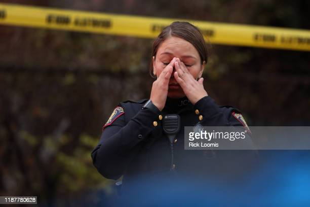 Jersey City police officer reacts at the scene of a shooting that left multiple people dead on December 10, 2019 in Jersey City, New Jersey. In a...
