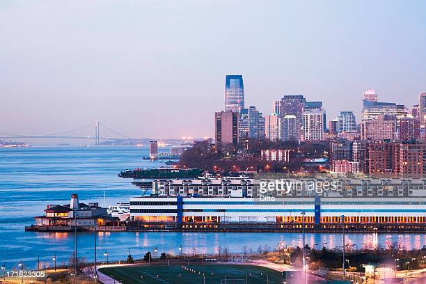 jersey city skyline and waterfront at dusk, new jersey, usa - jersey city stock pictures, royalty-free photos & images