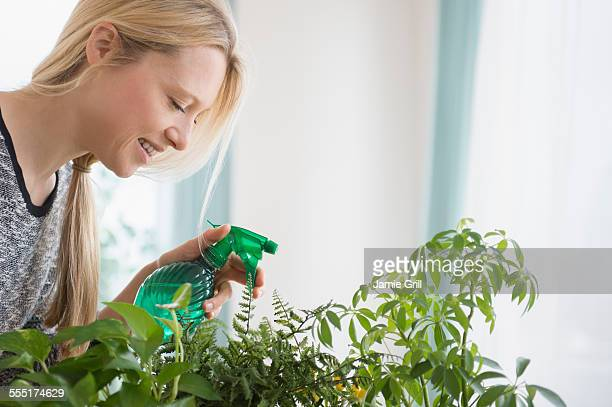 Jersey City, Woman spraying plants
