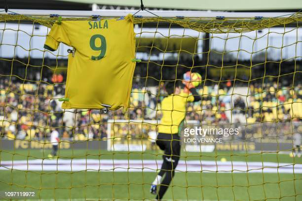 TOPSHOT A jersey is displayed on the goal in memory of late Argentinian forward Emiliano Sala prior to the French L1 football match between FC Nantes...
