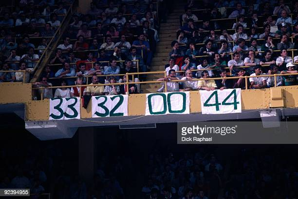 Jersey numbers of Larry Bird Kevin McHale Robert Parish and Danny Ainge of the Boston Celtics hang from the upper deck during a game played in 1987...