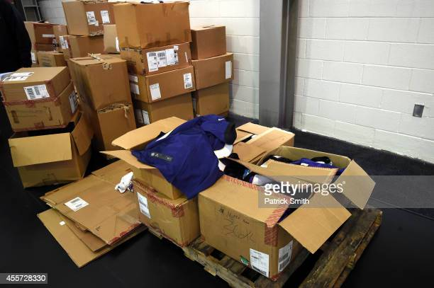 A jersey of of former running back Ray Rice of the Baltimore Ravens sits onto of a pile of boxes after a football fan stood in line to exchange the...