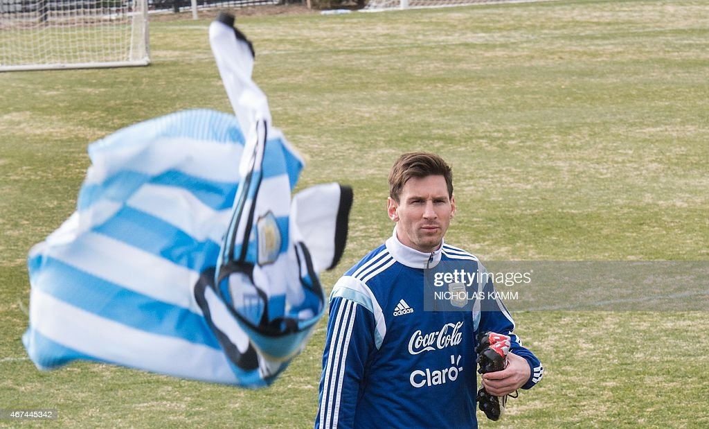 A jersey of the Argentinian national team is thrown at Lionel Messi for him to sign after the team's training session at Georgetown University in Washington, DC, on March 24, 2015 ahead of a friendly match against El Salvador.