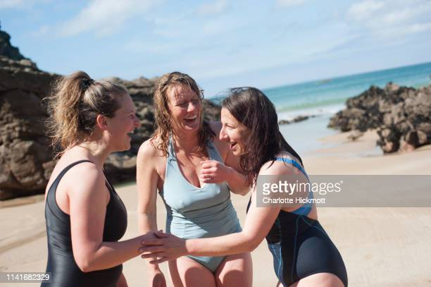 jersey sea swimmers - showus stock pictures, royalty-free photos & images