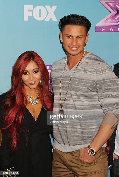 Jersey Shore cast Nicole 'Snooki' Polizzi and Paul 'Pauly D' DelVecchio arrive at Fox's 'The X Factor' Season Finale Night 1 at CBS Television City...