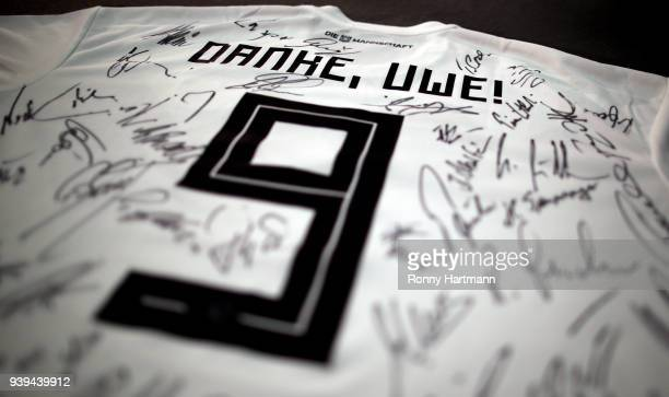 DFB jersey with the sign 'Danke Uwe' and autographs of former national players is pictured during the International friendly match between Germany...