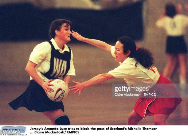Jersey's Amanda Luce tries to block the pass of Scotland's Michelle Thomson